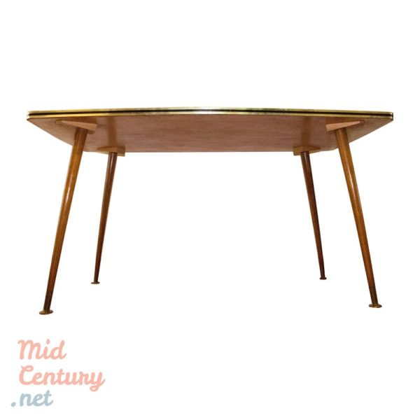 Coffee table with brass clogs and formica top