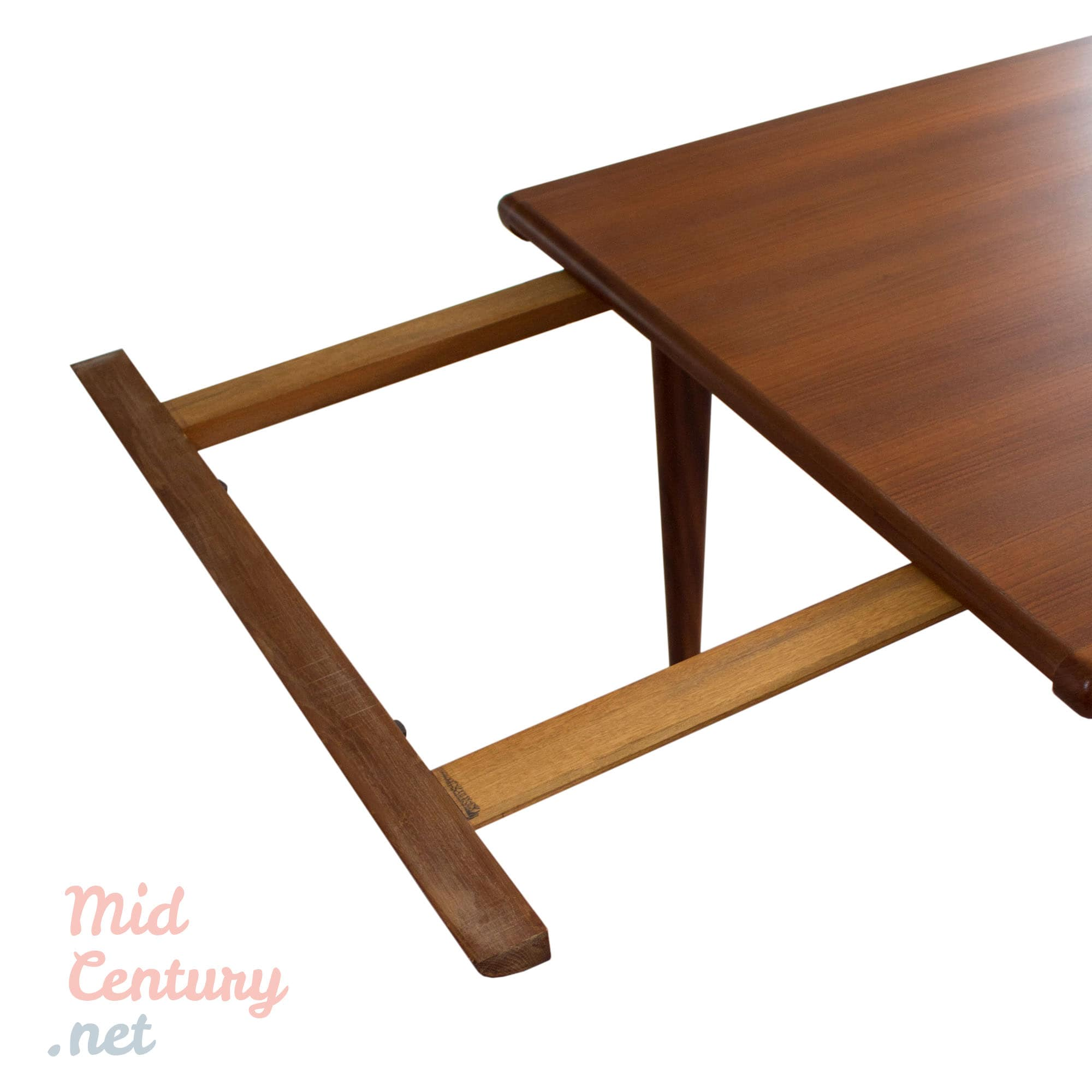 Extendable teak dining table and 6 Danish teak dining chairs • Mid