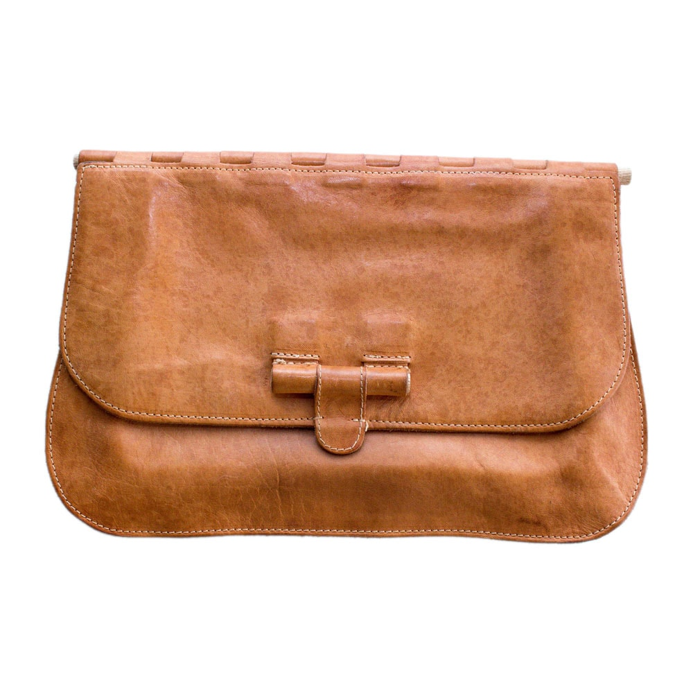 Brown leather clutch handbag