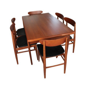 Extendable teak dining table and 6 Danish teak dining chairs