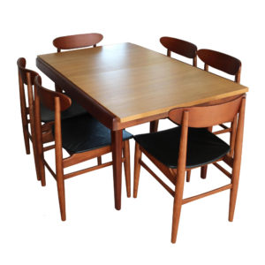 Extendable dining table made in France and 6 Danish teak dining chairs